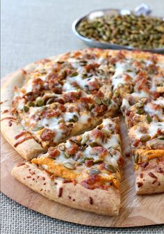 Spicy Sausage and Pumpkin Pizza is made with a store bought crust, spicy sausage and pumpkin seeds.