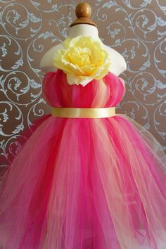 Flower Girl Tutu Dress, Beautiful Shades of  Hot Pink and Yellow, with Delicate Oversized Rose, tutu dress, flower top, toddler tutu dress. $52.00, via Etsy.