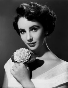 Elizabeth Taylor.  I loved seeing her as a child play the role of Helen in the movie Jane Eyre, 1943. <3