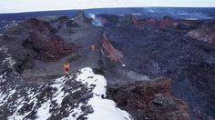 Four geologists in Iceland had one of the hottest jobs on Earth this week. To capture accurate measurements of toxic volcanic gases, the scientists climbed directly into Iceland's Baugur crater on Wednesday (March 4), where lava bubbled and frothed only three weeks ago. Baugur crater was the tallest and largest crater in the long line of sputtering cones built by the Barbarbunga eruption's spectacular fire fountains. The surface is still a red-hot 1,110 degrees Fahrenheit (600 degrees…