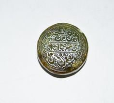I just discovered this A Rare Mughal Green Jade Seal CIrca Late 18th Century on LiveAuctioneers and wanted to share it with you: www.liveauctioneers.com/item/40435949