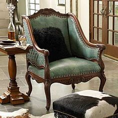 TURQUOISE CROCO CHAIR  #212634  This exotic looking chair has an air of sophistication. Embossed Croco leather in turquoise covers the inback, inside arms, and seat and is accented with nailhead trim. Diamond quilted leather covers the outback and sides with nailhead trim. The hand rubbed burnished antique finish of this chair completes an elegant look