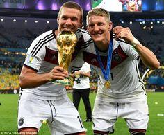 All smiles: Schweinsteiger celebrating with team-mate Lukas Podolski...