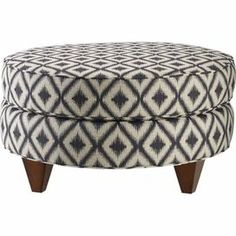 """Bring stately style to your living room or den with this cotton-upholstered cocktail ottoman, showcasing a diamond motif and square tapered legs.    Product: Cocktail ottomanConstruction Material: Cotton, polyester and woodColor: Charcoal and espressoFeatures: Square tapered legsDiamond motifMade in the USADimensions: 17"""" H x 30"""" DiameterAssembly: Simple assembly required"""
