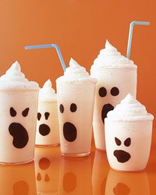 These spirits may look frightening, but they're actually quite sweet. Make the Faces with melted chocolate painted inside the glass. A ghostly white vanilla milk shake is topped with piped whipped cream. And although you wouldn't want these spooks to haunt your house, they would be welcome at a Halloween get-together.