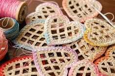 Cut out paper hearts with crocheted or tatted edges...These would make great Christmas ornaments....just need to learn to crochet or tat..