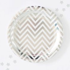 Enjoy your scrumptious party bites on these gorgeous metallic silver chevron party plates. Small size plates, are perfect for appetizers or cookies and cupcakes!  You will receive: 10 small paper plates Aprox. 7  diameter Designed by Illume, Australia.  Be sure to check out all our disposable paper products: plates, napkins and paper cups to coordinate your party perfectly to your hearts desire! Mix and match a few sets to keep it fun and to create a unique and unforgettable look;)  Plates…