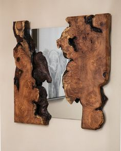 We created this one of a kind natural rustic live edge wall mirror from storm fallen reclaimed Mesquite burl that we've inlayed mirror into. Mounts to the wall with aluminum french cleats.