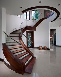 spiral staircase designs attached to wall  full guide to choose, design and install a perfect modern staircase design  expert tips for stair handrails, spiral staircase designs, LED stair lights and collection of other contemporary staircase design ideas