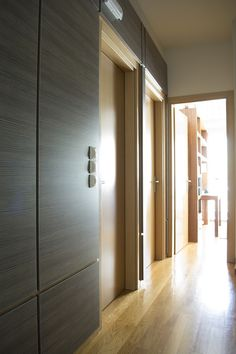 The wood panelling in the corridor leading to the children's bedrooms is easy to clean and the perfect material to wipe away 'sticky fingers'. #luhadesign. #interiors, #interiorideas, #corridors, #wood, #woodpanelling