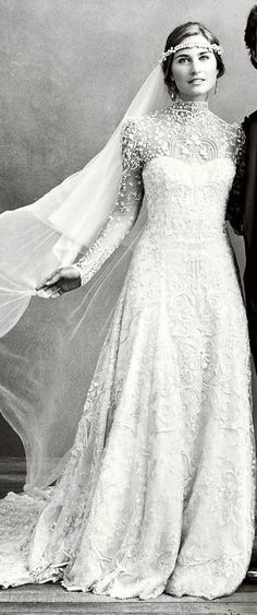 Not vintage but certainly vintage inspired ... in 2011, President George H. Bush's niece (and President George H. W. Bush's granddaughter), Laura, wore a wedding gown designed by her future father-in-law, Ralph Lauren. longsleeved