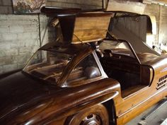 "This replica of the Mercedes-Benz 300SL Gullwing model 1955 issue entirely made ​​of teak wood species. Even the wheels and unique door ""gull wing"" made ​​of wood."