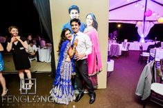 Indian wedding reception with life size cut-outs of the bride and groom at Lake Lanier in Atlanta, Georgia