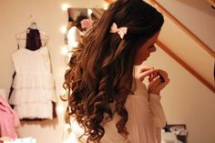 I love how the curls and the bow looks