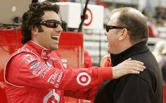 Dario Franchitti laughs with his car owner Chip Ganassi