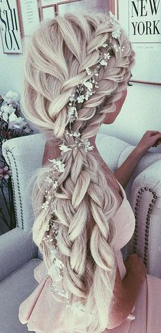 This beach wedding hairstyle is gorgeous! I love the long romantic braid with flowers in it. So cute!