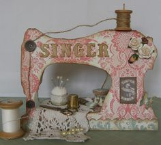 Sewing Machine. Link takes you to Martha's blog where there are close ups of this card. Like the idea of the machine name as well as buttons for the tension Also the patterned paper/card for the machine itself. Great design ideas here.