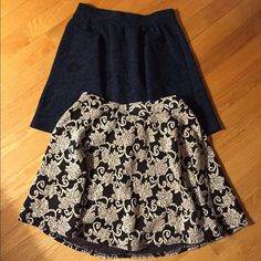 Two Lace Design Floral Skirts These two skirts are adorable! The bottom skirt is white and black and the top is black and a dark teal color. The quality of these skirts it's very nice and they are both in excellent shape. Only worn a couple of times. Joe Benbasset Skirts Mini
