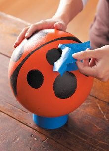 Upcycle an old bowling ball (thrift store) into a painted garden ornament for kid's flower bed.