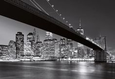 A snazzy black and white mural, depicting NYC at night. The dramatic play of light on the water and the twinkling lights of the city give this mural a glamorous, classy air. Printed On Strippable Non Woven Paste Not Included Measures Comes in 8 pieces City Wallpaper, Photo Wallpaper, Wall Wallpaper, Brooklyn Bridge, Nyc At Night, Barbershop Design, Manhattan Skyline, Window Films, City Lights