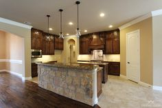 Natural stone and glass light fixtures add texture to this traditional #kitchen #ourcountryhomes
