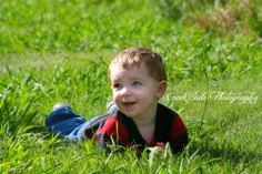 toddler playing in grass picture
