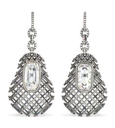 SPECTACULAR DIAMOND EAR PENDANTS, BY JAR. Each set with a rectangular table-cut diamond weighing 9.72 and 7.68 carats to the pear-shaped ear pendant of diamond-set cage design and diamond link surmount, created in 2005, 9.0 cm. long, in JAR red leather case. Each signed JAR (2). Price Realized $576,000 / Estimate $500,000 - $700,000 [C. CONTEMPORARY JEWELS AND WATCHES - 31 January 2007 - Dubai] #JAR #JARParis #JoelArthurRosenthal