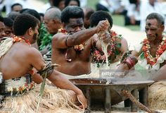Preparing traditional Kava drink at ceremony, Fiji, South Pacific.