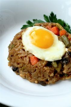 Lunch or dinner-veggie risotto with egg. Replace the mushroom with something.