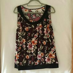 Floral Tank Top Up for sale is a floral tank top by Christopher & Banks.  It has a black bow on the left shoulder. Colors are burgundy, black, orange, dark mauve and olive green. Really comfy material! Christopher & Banks Tops Tank Tops