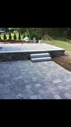Multi Level Paver Patio Field Stone Wall With Granite Cap Slab Steps