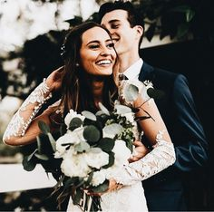 fall wedding. long-sleeve dress. natural greenery for bouquet