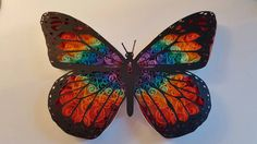 Beautiful hand cut/hand quilled butterfly, made by myself using acid free 10mm quilling papers and so silk black paper. Will be framed within a box frame of your choice, black or white. The frame is approx 28cmx23cm. I can make any colour you like including colours not pictured just pop me a message upon ordering. I can also offer a small amount of papercut text for £5 extra please choose the option from the menu and pop me a message with what youd like :) x