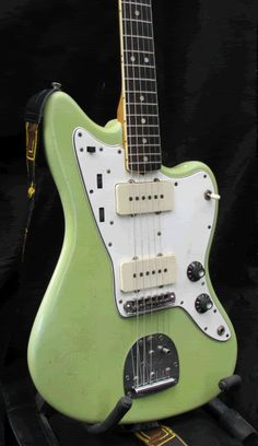 Sonic Blue Jazzmaster faded to a minty green