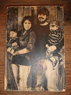 Print your picture out on plain paper, Take piece of wood and coat with mod podge, turn picture upside down on wood, press and let dry overnight. next day using water and your hands rub paper off of wood (your picture will be on the wood) now cover with more mod podge.