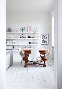 dining room inspiration. modern white chairs with traditional wood table.