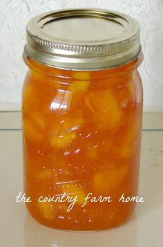 Making Amish Peach Jam.  Love the jar in a pan trick!