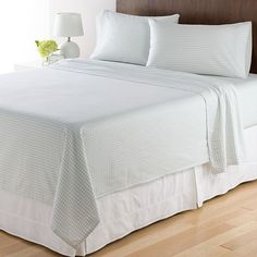 Lauren - Queen Size Sheets in white, grey or taupe. Example: Home Classics Flannel Sheet Set from Kohls for $40.00 in Ivory Houndstooth