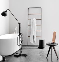 Lightweight with a rounded base, this steel and oak towel ladder with leather accents is the epitome of understated elegance.