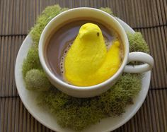 Here's a fun idea for the Easter breakfast table, peeps in hot chocolate. Peeps are basically marshmallows covered in yellow sugar. Make sure to put the peeps in just before serving, after a while they will begin to melt and tip on their sides.