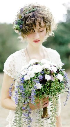 Boho bride's short curly wedding hairstyle with flower crown corona halo  ♔