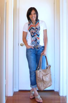 I like the scarf tied loosely at her neck to add color to a casual look.