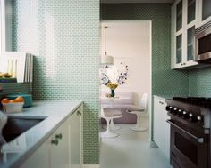 Midcentury - Green tile and white cabinets in a kitchen. Instead of the kitchen, I'd like to see this in the bathroom.