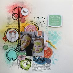 Colourful freestyle scrapbook layout using mists and black gesso on the background.