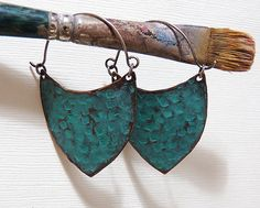 Created in my studio, these Verdigris Copper shield shaped hoop earrings are created with hand-cut hammer distressed copper, patterned with