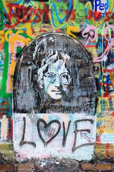 Photographed on the Lennon Wall In Prague, Czech Republic (a little bit of ours showing!) @Christina Roberto