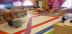 """""""We want people to know they're in the library, of course, but also to know they're in Boston,"""" Colford says. Part of the way this makes its way into the Children's Library is colored stripes running along the floor that echo MBTA train maps. (Greg Cook)"""