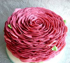 "Star Bakery - Rose petal piped buttercream. It's a 6"" cake done with a 104 tip."