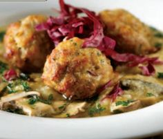 Tires of the same old spaghetti and meatballs? Try this delicious recipe from The Catering Company. Oven-Roasted Pork Meatballs with Cheesy Grits, looks divine!