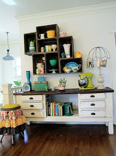 Artist Kelly Rae Roberts has a great DIY wall storage idea: mount crates to the wall to display your kitschy pottery.